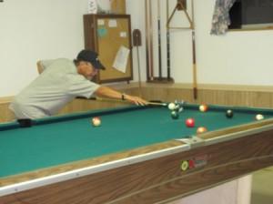 Dennis playing a corner shot (2012)